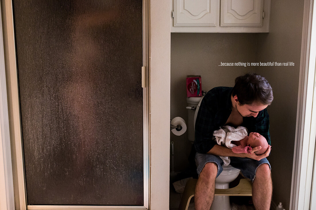 In dallas texas, Lawren Rose Photography takes a photograph of brand new parents in the bathroom, the mother is taking a shower and the father is sitting on the toilet next to her holding their new baby