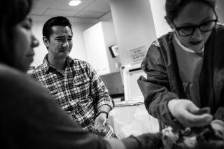 Lawren Rose Photography captures a photo of a Dad crying the minute he hears his newborn son cry at Baylor University Medical Center in Dallas Texas