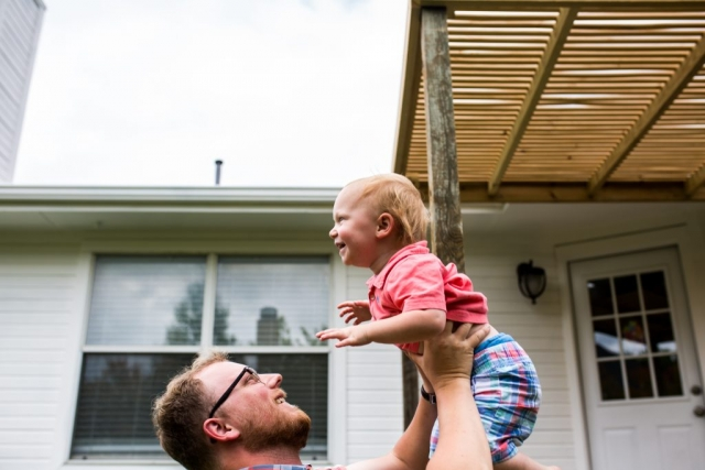 Lawren Rose Photography documents a family in their home and captures a photo of a father about to throw his son in the air in McKinney Texas