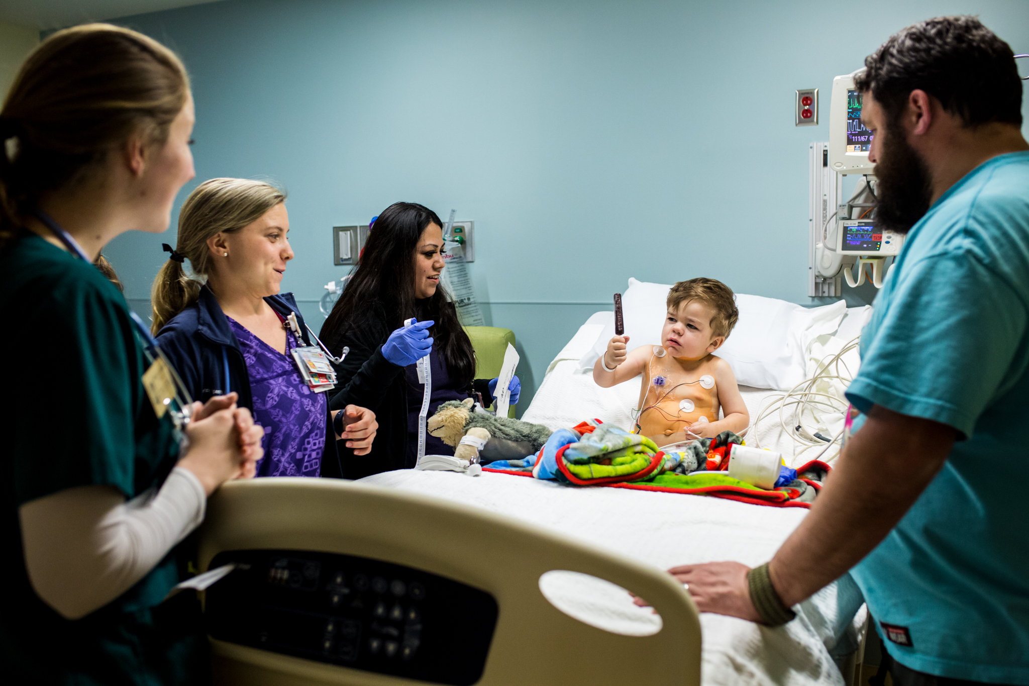 boy in a hospital bed eating a popsicle