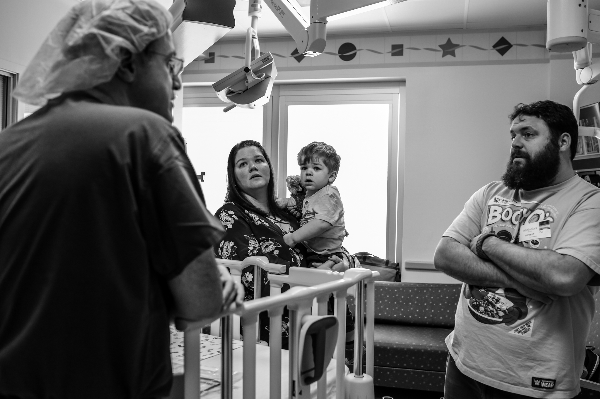 doctor talking to parents before their son goes into surgery