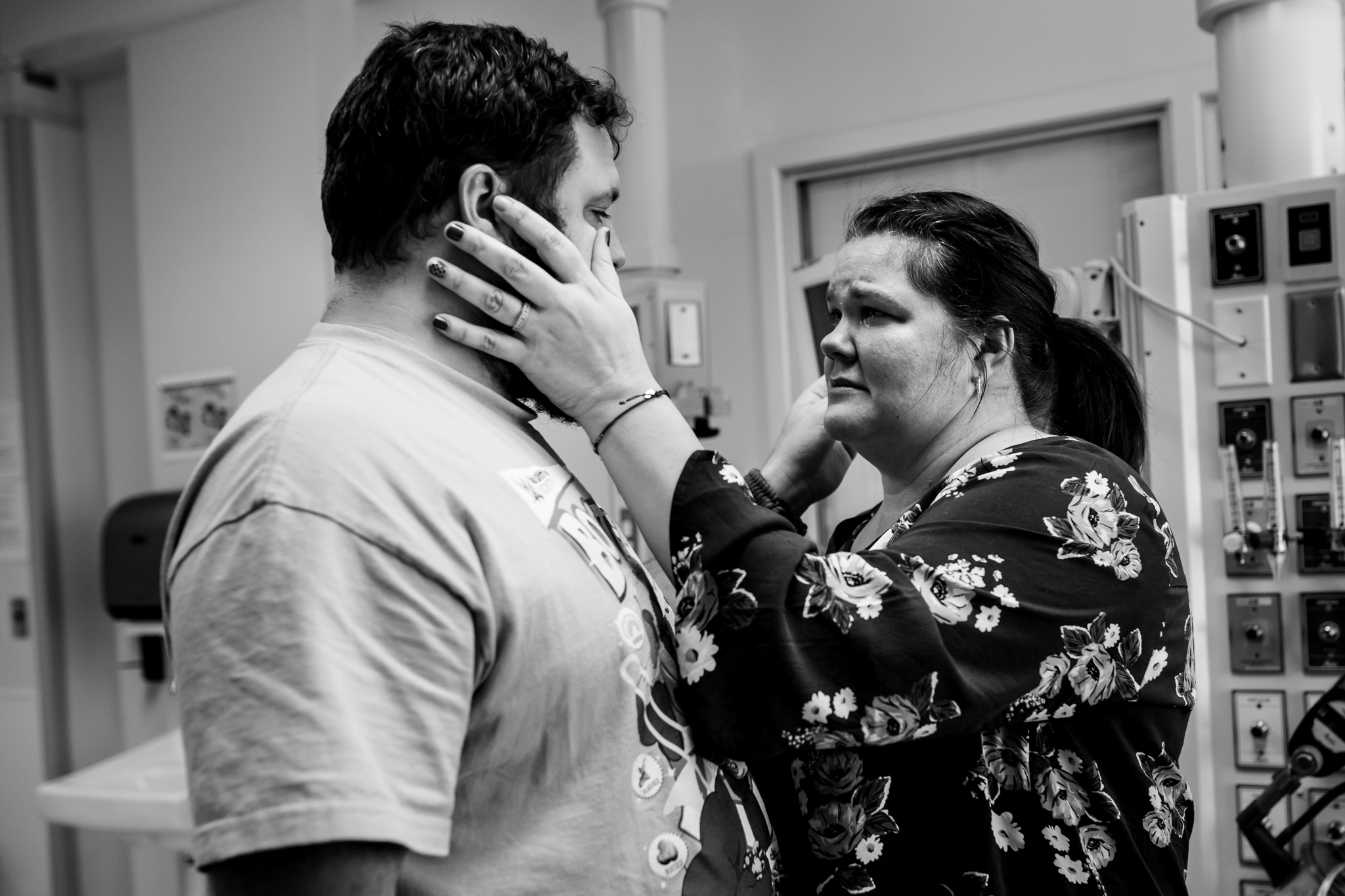 husband and wife look to each other for support
