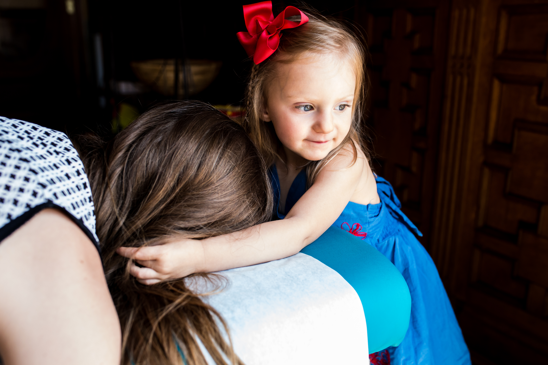 Daughter caressing Mom's hair