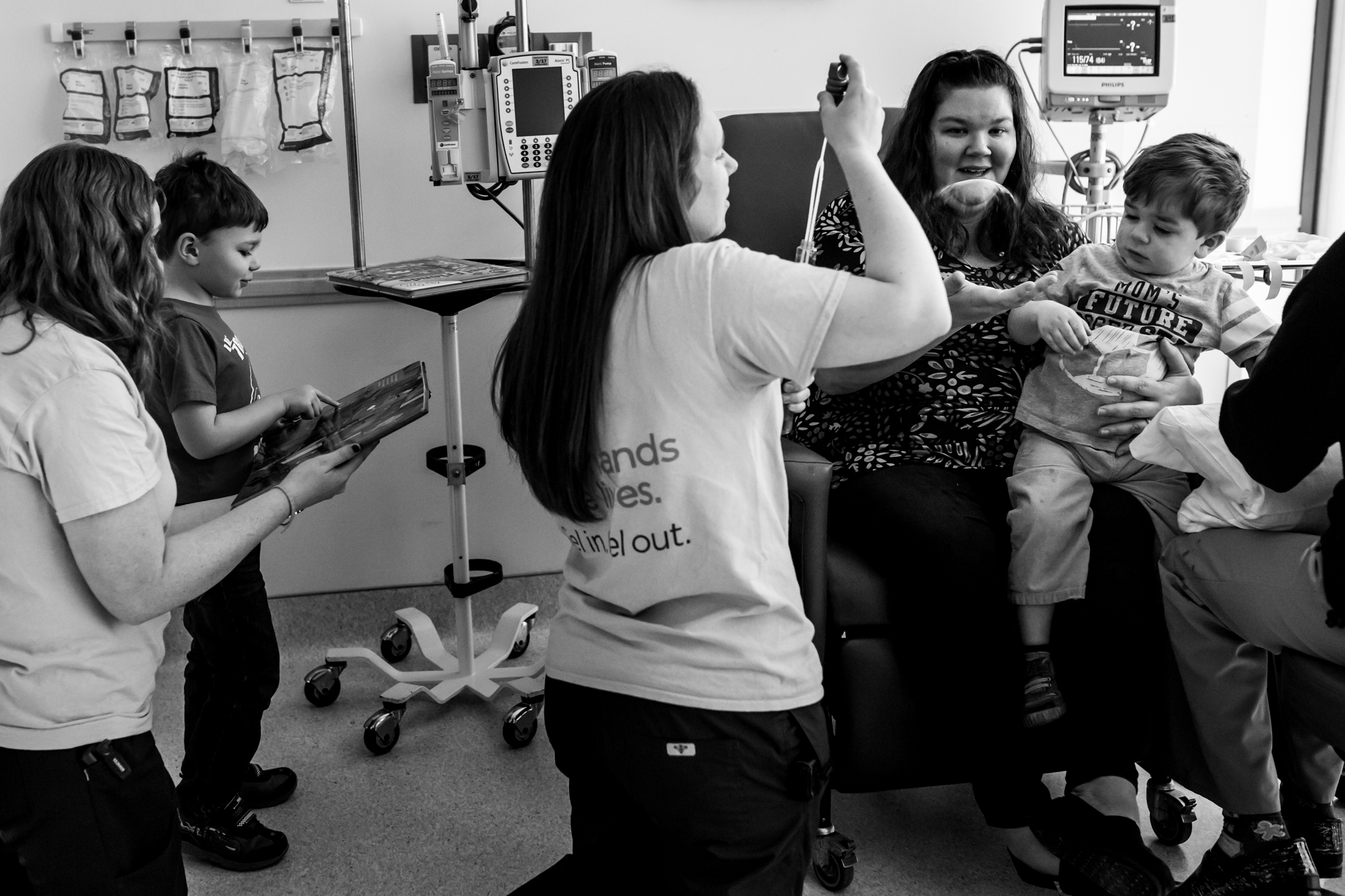 nurses in the childrens hospital try to distract kids while they get an iv