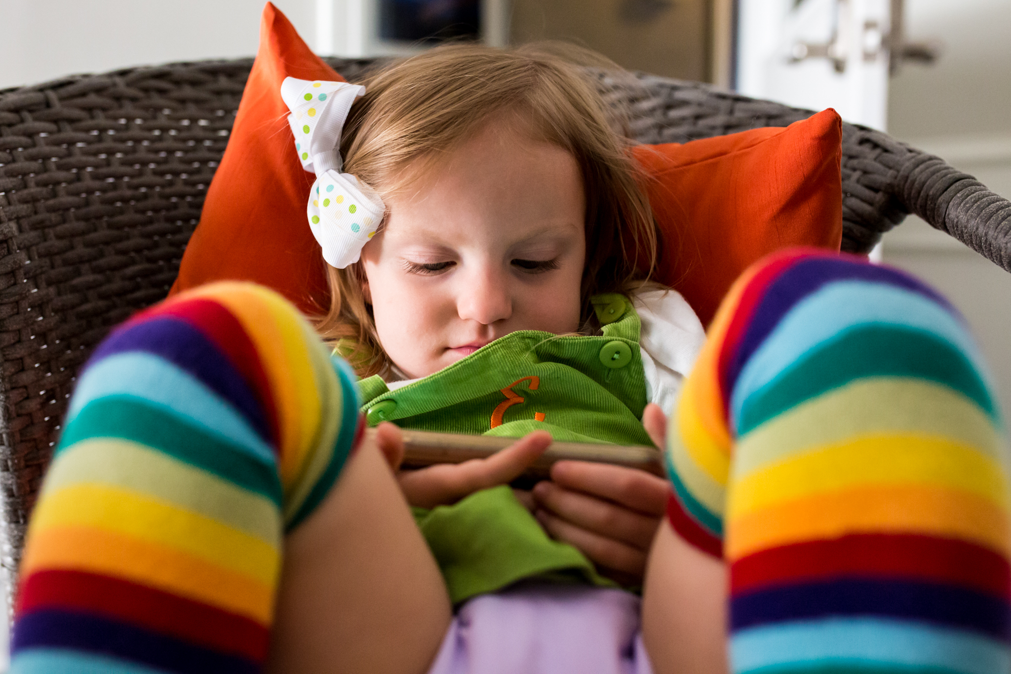 little girl wears rainbow clothing