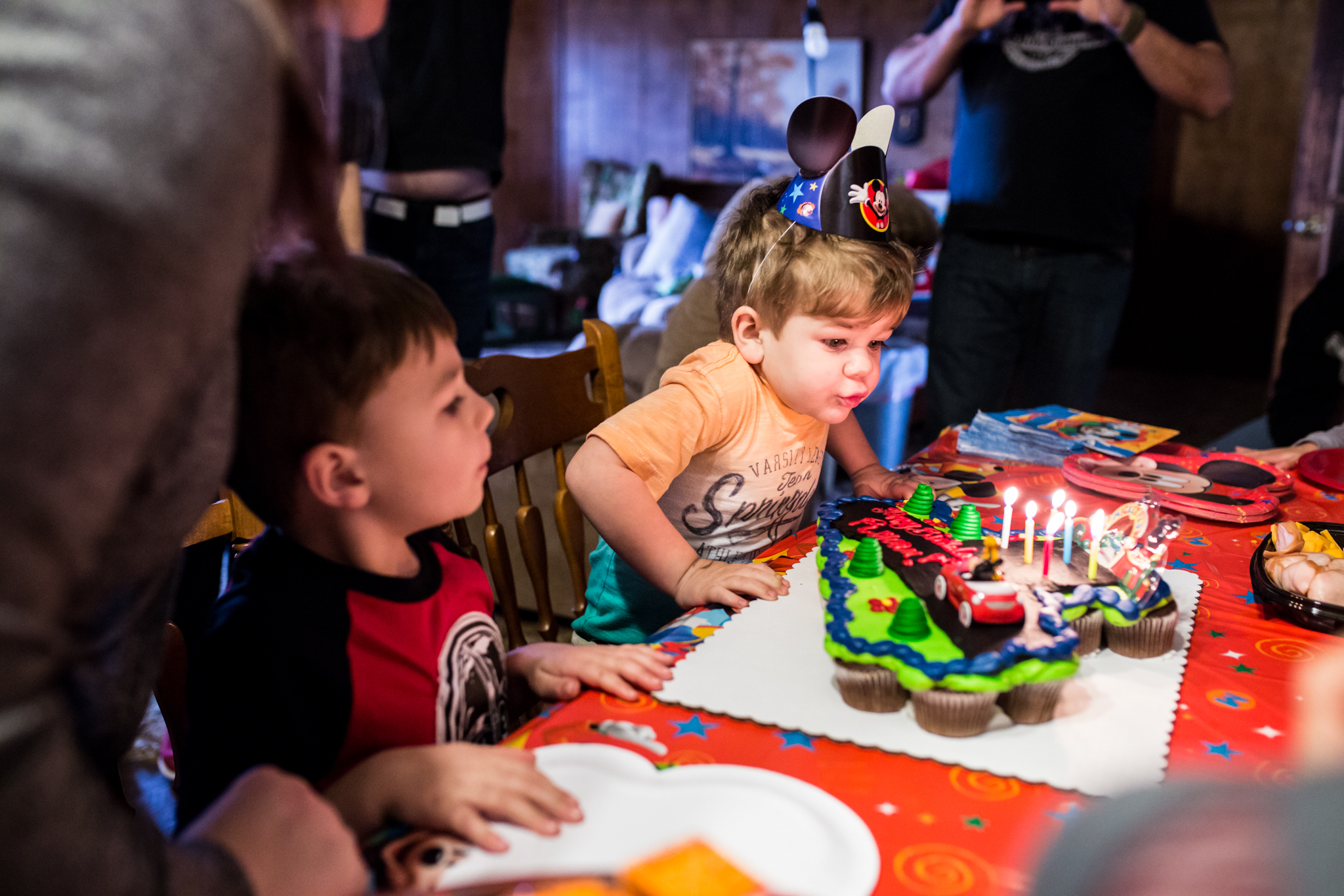 little boy blows out birthday candles