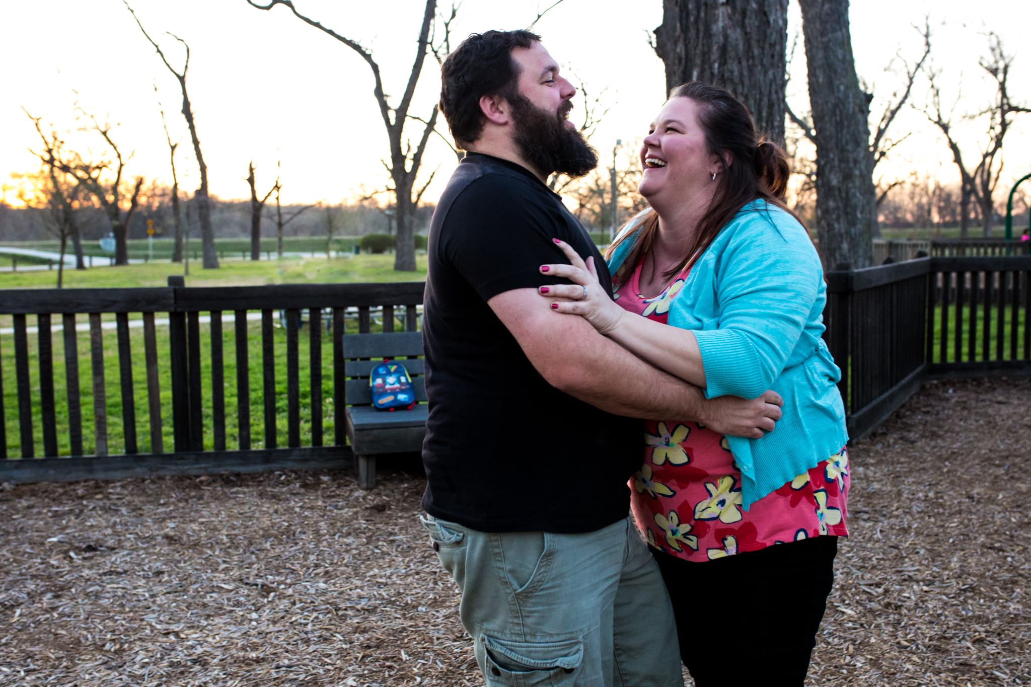 husband and wife laughing and holding each other