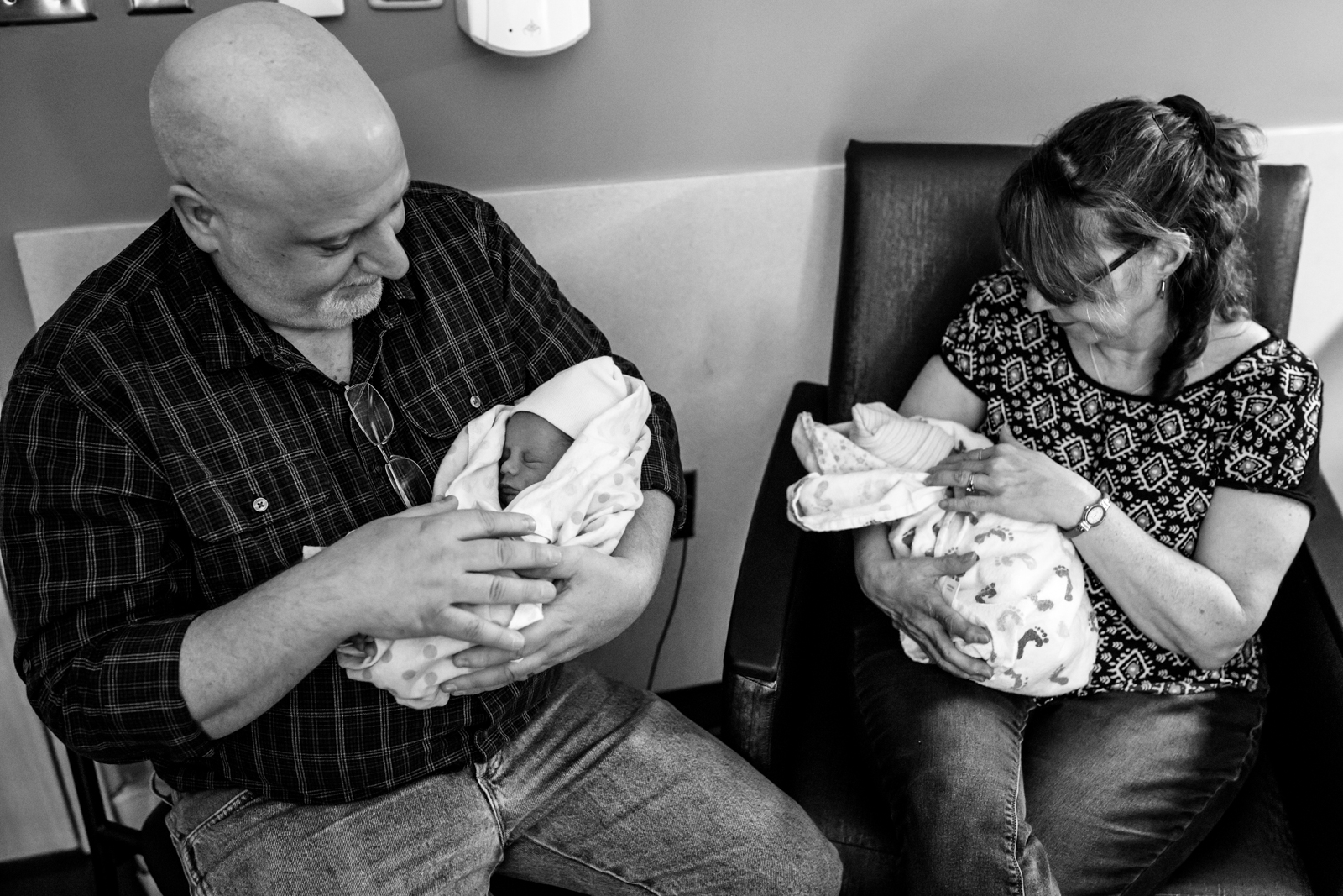 grandparents hold their grand children