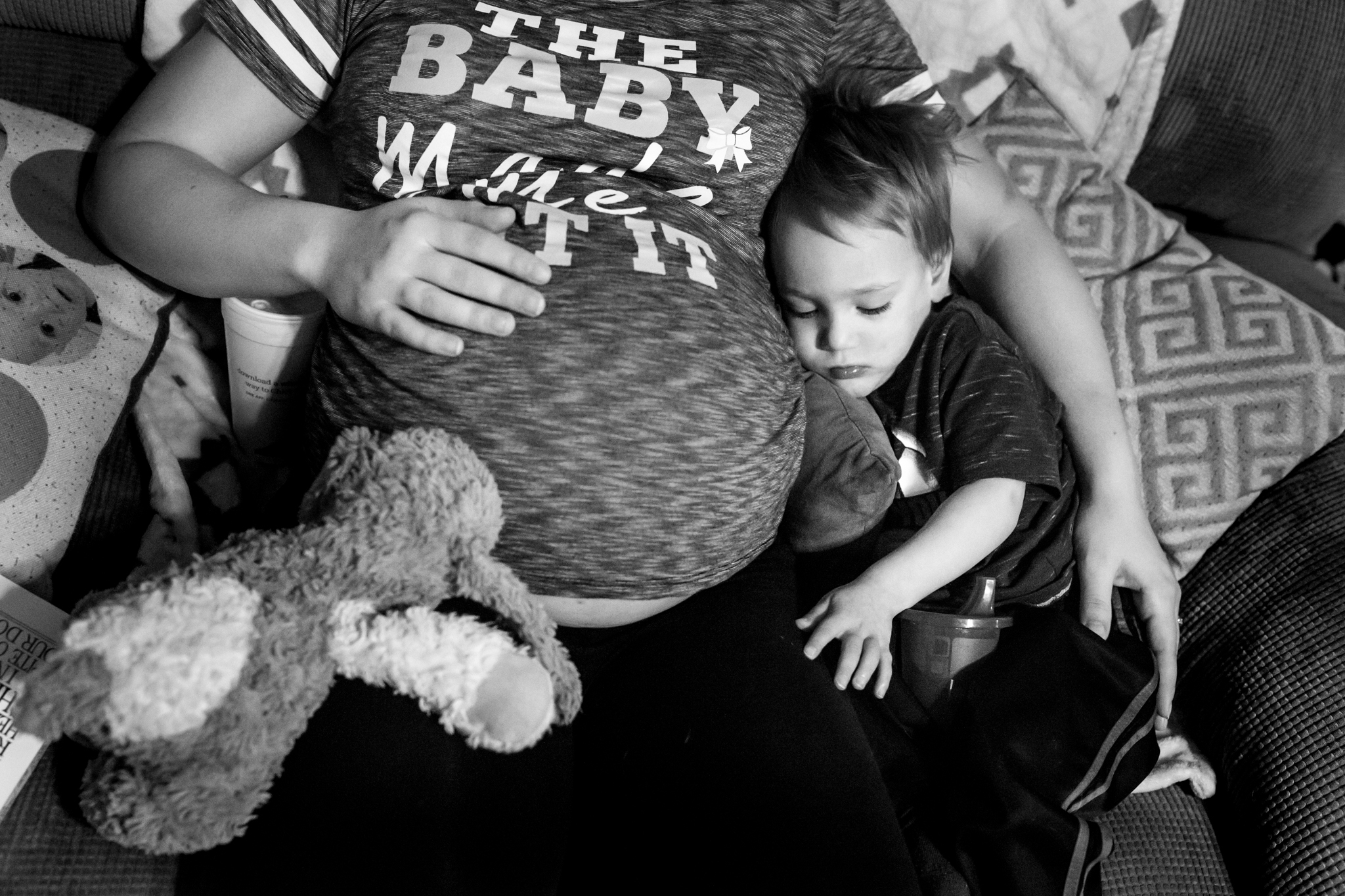 Maternity Photographer Lawren Rose Photography captures a moment where a 2 year old son is cuddling with his moms pregnant belly in dallas texas