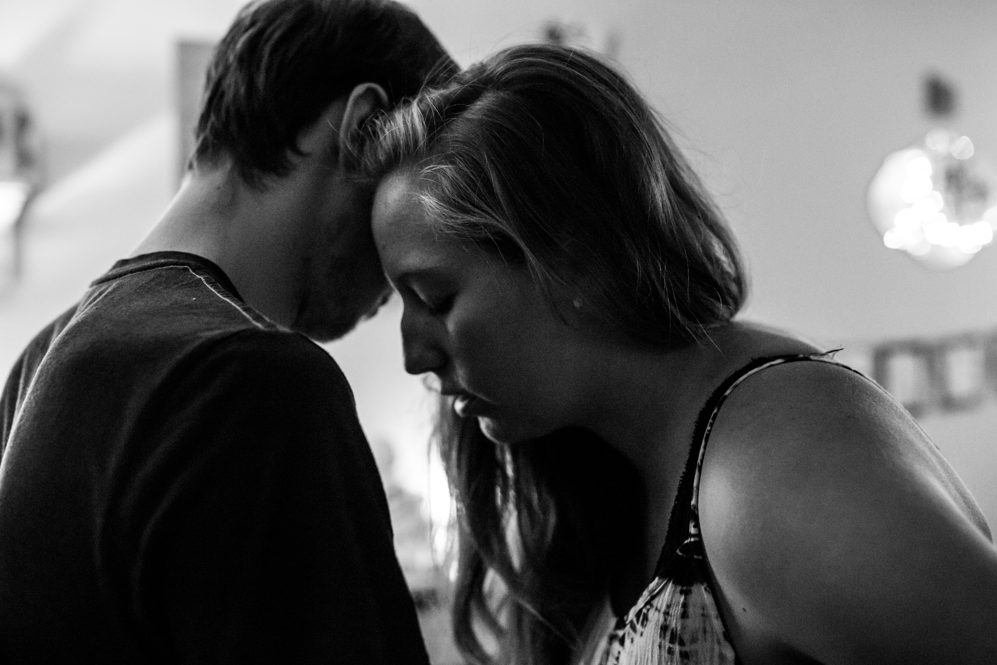 Lawren Rose Photography Dallas Birth Photographer takes a picture of a husband and wife standing very close with their faces near each other during a contraction