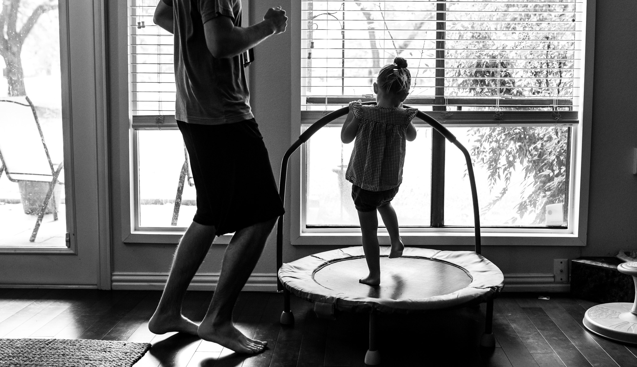 Lawren Rose Photography takes a photo of a father dancing and jumping with his 2 year old daughter