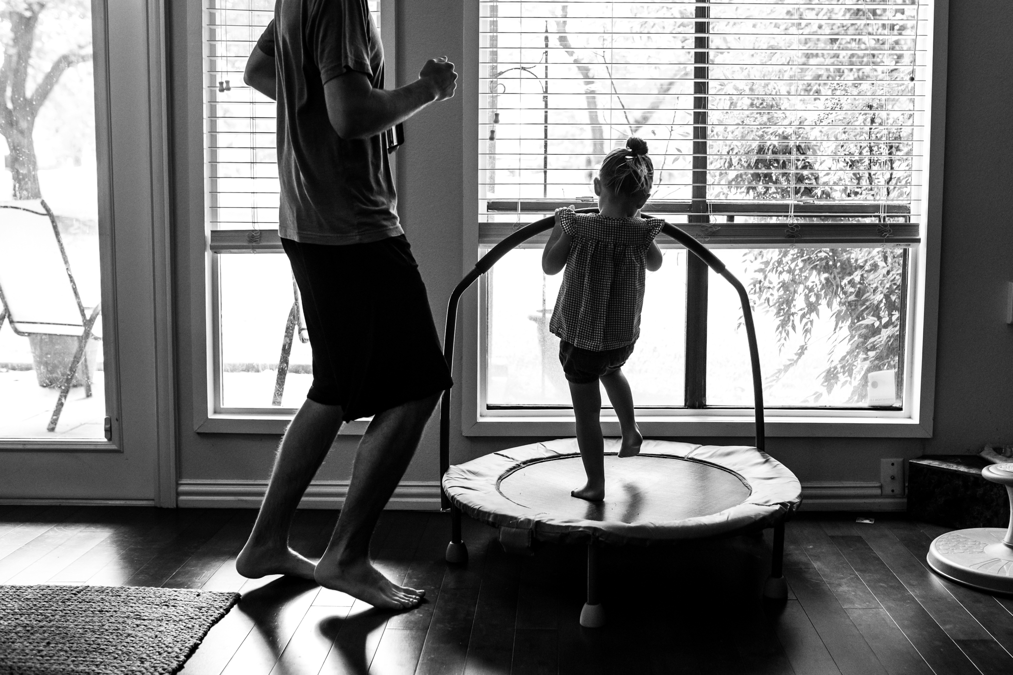 Lawren Rose Photography, a documentary family photographer in dallas, takes a picture during a Day In The Life session of a little girl and her dad dancing in front of a window