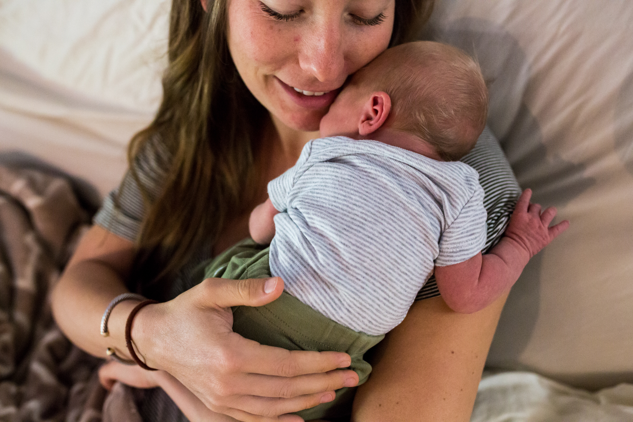 Lawren Rose Photography captures a very sweet and real moment of a mom cuddling her 3 day old son during an in-home newborn session in dallas texas