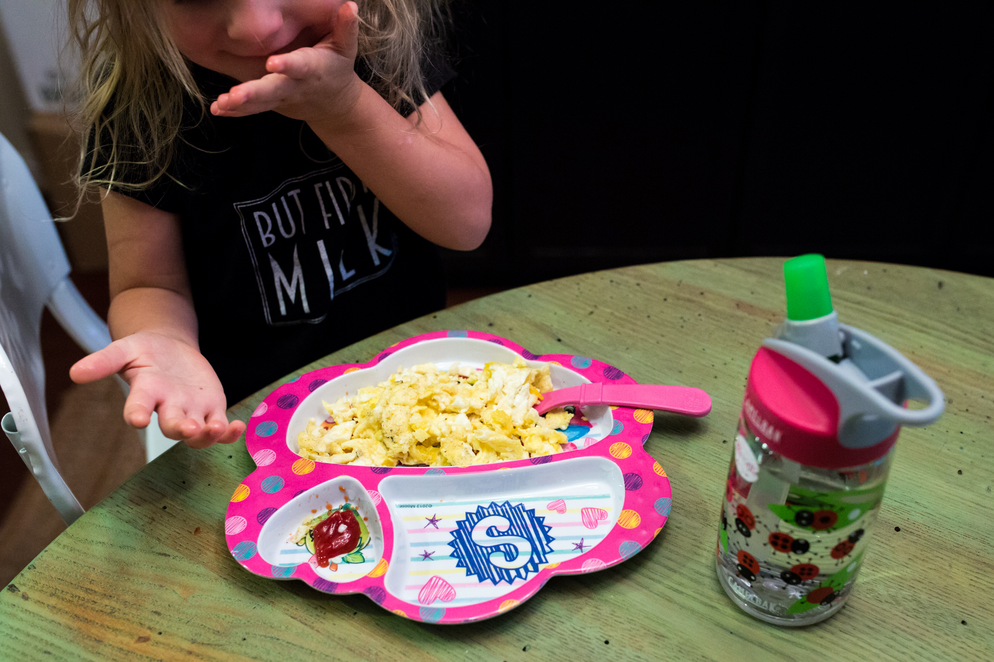 Little girl eats eggs and ketchup for breakfast in farmers branch texas, taken by Lawren Rose Photography