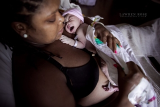 McKinney texas birth, Lawren Rose Photography takes a quick photo of a mom holding her baby and putting a cover over her