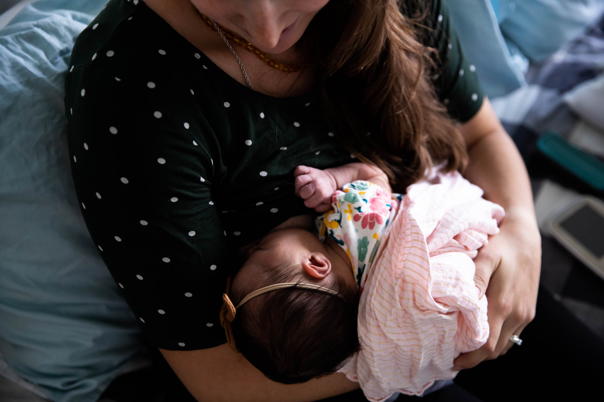 Documentary family photographer, Lawren Rose Photography, captures a sweet moment with a newborn breastfeeding