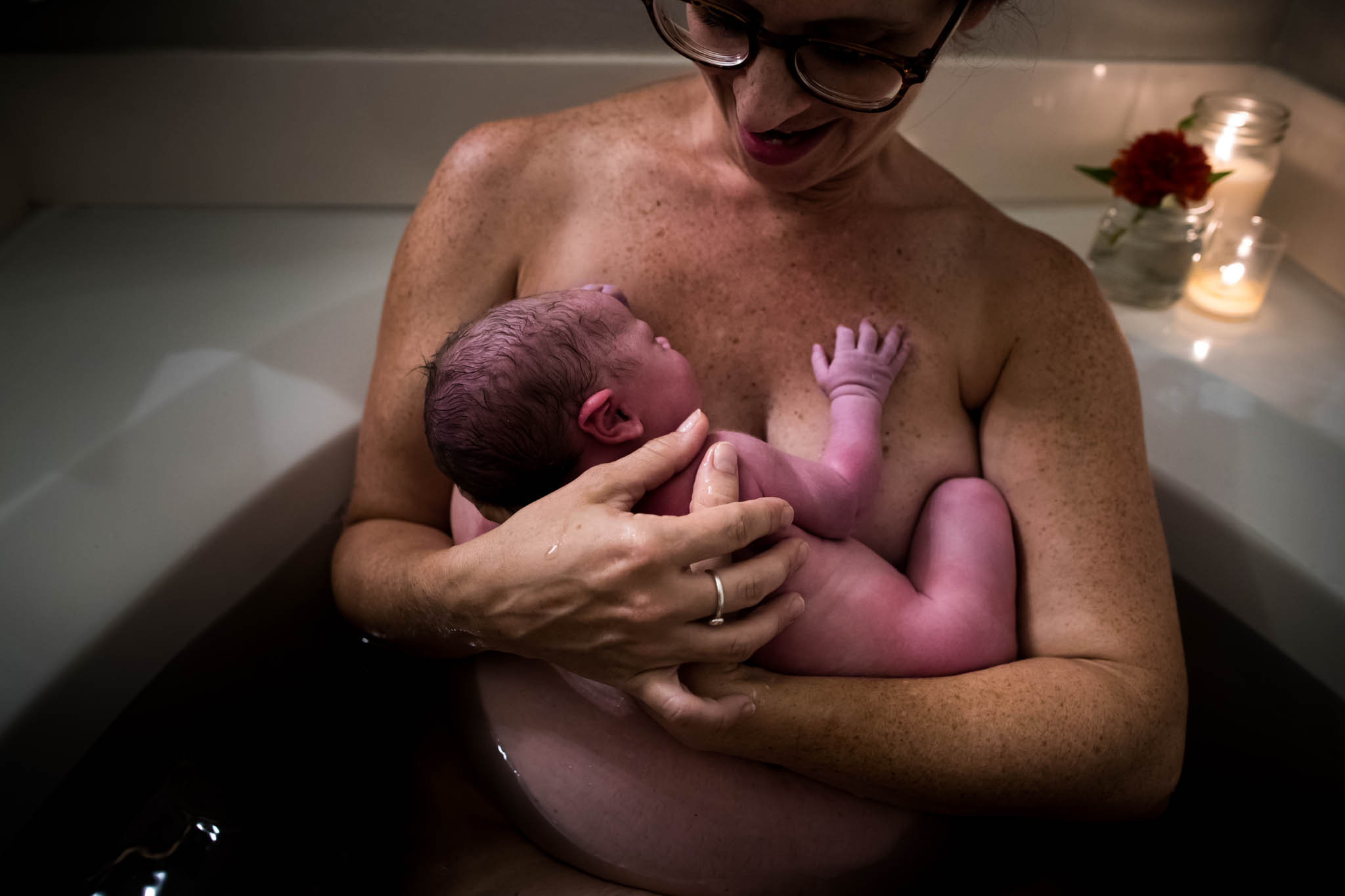 A dallas birth photographer Lawren Rose Photography takes an image after a Denton texas home birth as Mom got into an herbal bath with her newest son